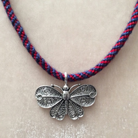 Red & Navy Kumihimo Cord Necklace With A Large Silver Butterfly Charm.
