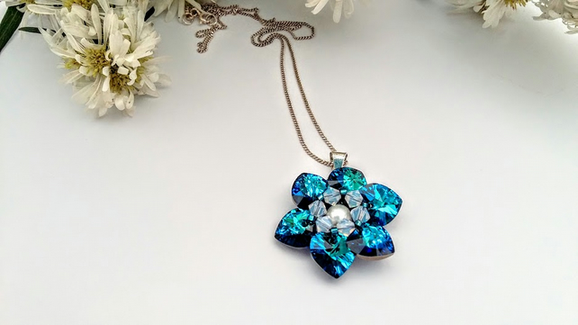 Blue Zirconia Heart Daisy Pendant.  Sterling silver bail and chain