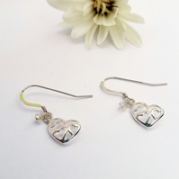Sterling Silver Heart Earrings adorned with a little Swarovski Crystal.