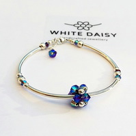 STERLING SILVER BRACELET ADORNED WITH BEAUTIFUL BLUE SWAROVSKI CRYSTALS