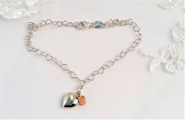 Sterling Silver Heart Chain Bracelet with a Puffed and Gold Vermeil Heart