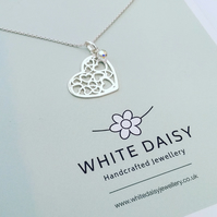 STERLING SILVER HEART PENDANT WITH A PRETTY CUT OUT DESIGN.