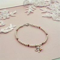 STERLING SILVER BOW BRACELET WITH SWAROVSKI ROSE GOLD BICONES AND PEARLS