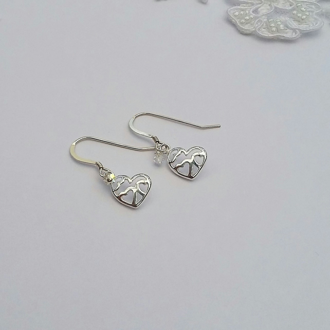 STERLING SILVER CUT OUR EARRINGS WITH A SPLASH OF CRYSTAL