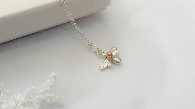 Honey bee pendant carrying a little rose gold with Free Delivery