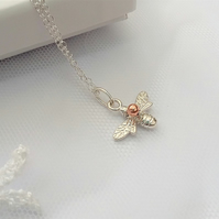 Sterling Silver Bee pendant carrying a little Rose Gold