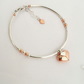 Sterling silver and rose gold vermeil heart bracelet