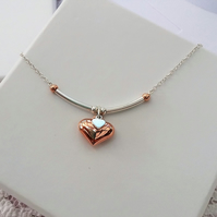 Rose gold and silver heart pendant