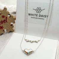 Sterling silver hearts stacker necklace set.