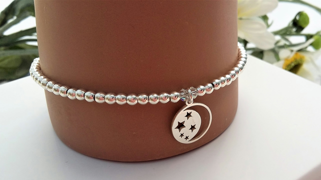 Sterling silver moon and stars charm bracelet with a tiny sparkle of Swarovski