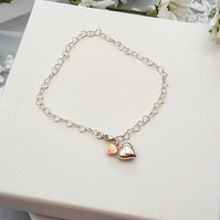 Sterling silver heart bracelet with the option of rose or yellow gold heart