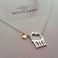 Giraffe pendant in sterling silver with a little rose gold heart.