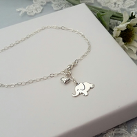 Sterling silver elephant and puffed heart charm bracelet