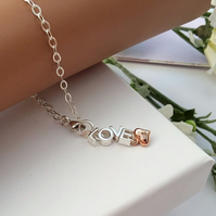 Sterling silver LOVE bracelet with a rose gold heart introductory price