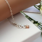 Sterling silver LOVE bracelet with a rose gold heart