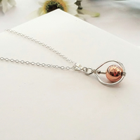 Sterling Silver Pendant with a Rose Gold Bead wired inside the silver frame