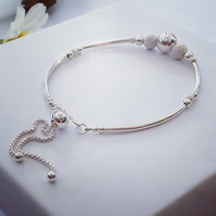 Sterling Silver bangle style Bracelet designed with smooth and laser cut beads