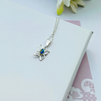Butterfly necklace in sterling silver with a tiny Swarovski crystal in blue