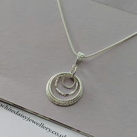 Sterling silver twisted rings pendant for a 50th birthday or anniversary