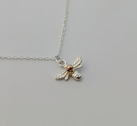 Bee necklace in sterling silver with a bead of rose gold