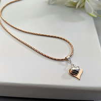 Necklace of Two Hearts on a Beautiful Light Catching Sparkling Rose Gold Chain