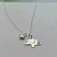 Elephant Necklace with a Puffed Heart Charm in Sterling Silver