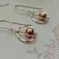 Earrings Rose Gold Bead Set Within a Sparkly Twisted Sterling Silver Hoop