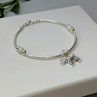 Sterling silver dog charm bangle style bracelet with sparkly lazer cut beads