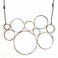 Asymmetric sterling silver circles bib necklace