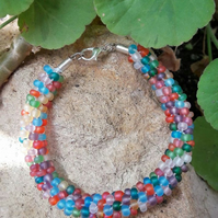 Multicoloured beaded bracelet - Kumihimo