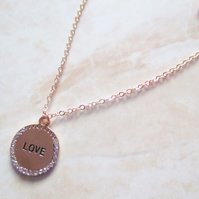 90% OFF SALE. Rose Gold and Crystal Love Pendant