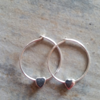 Sterling Silver 18mm hoops with heart charms.