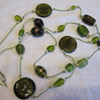 Extra long beaded necklace in shades of sage green
