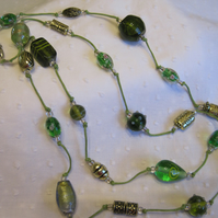 Long beaded necklace and earring set in shades of soft green and gold
