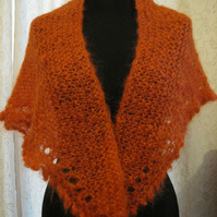 Hand knitted mohair wrap in deep orange