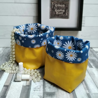 Two mustard and Daisy Matt Oilcloth Contemporary Storage Baskets