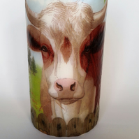 decorated cow candle