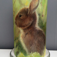 rabbit in meadow candle