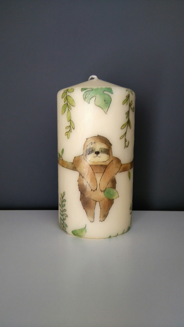 sloth decorated candle