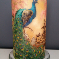 peacock decorated candle
