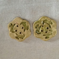 PairCeramic green flower buttons with chasing bunnies
