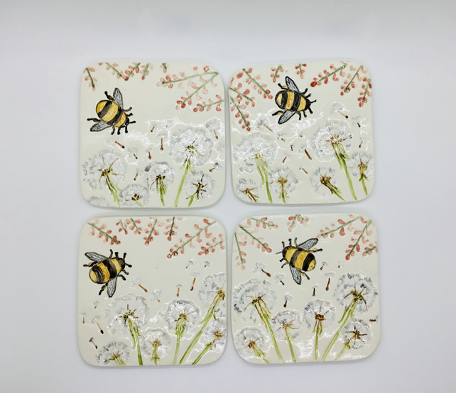Set of Four Handmade Ceramic Coasters with Bumble Bees and Dandelion Seed Heads.