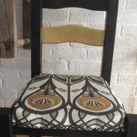 Overhauled chair in black and gold