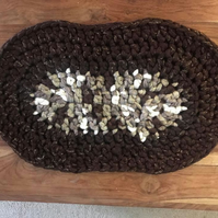 Crocheted runner or table mat