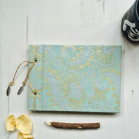 Handmade notebook. Japanese bound recycled paper finished with metal charms.