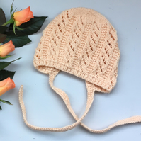 Pretty Apricot Knitted Bonnet