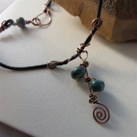 Leather cord necklace with copper spirals and handpainted clay beads
