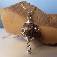 Sterling silver wire-wrapped necklace with leopardskin jasper bead