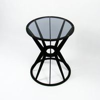 Designer laser cut plywood stained side table with acrylic glass inserted top.
