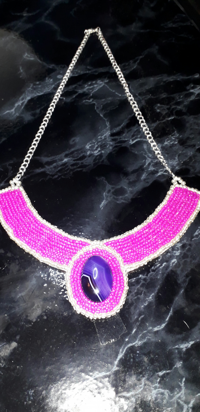 Pink and purple beaded necklace with cabochon